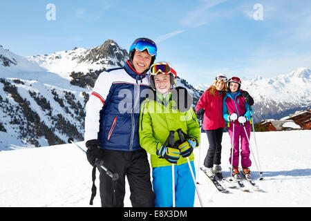 Father and son skiing together - Stock Photo