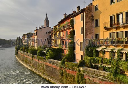 Colorful houses on the bank of river Adige in Verona Italy Europe - Stock Photo