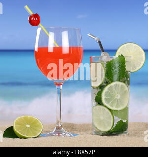 Cocktails and cold drinks on the beach with sand and sea - Stock Photo