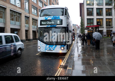 London, UK. 15th October, 2014. A number 8 double-decker bus advertising Youtube/TheSlowMoGuys on its way to Bow - Stock Photo