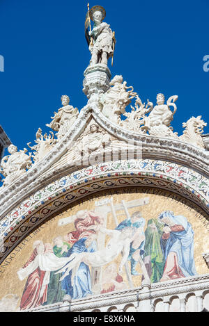 Exterior mosaic on St. Mark's Basilica in Venice, Italy - Stock Photo