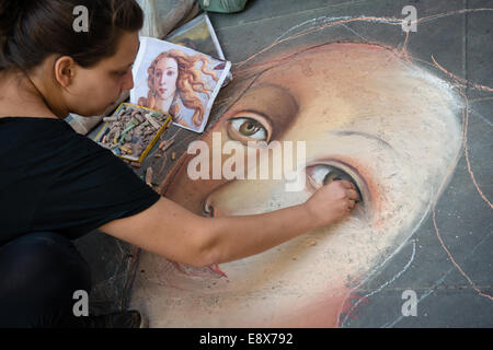 FLORENCE, ITALY - SEPTEMBER 15, 2014: artist painting face of Venus (from Botticelli) on the pavement by chalk, - Stock Photo