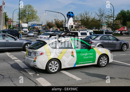 A Google Street View mapping vehicle in car traffic, Vancouver, B.C., Canada - Stock Photo