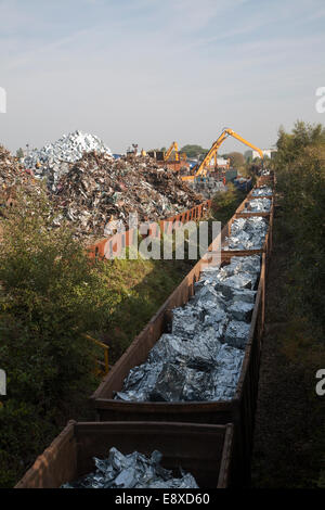 Scrap metal recycling loading train wagons with processed metals, EMR company, Swindon, England, UK - Stock Photo