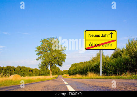 Traffic sign with New Year Eve terms - Stock Photo