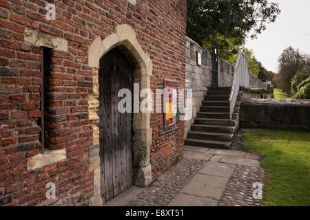Side view of entrance & doorway of the historic Red Tower & beyond, steps leading to a section of city walls - York, - Stock Photo