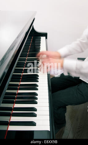 Ghostly hands on piano keyboard - Stock Photo
