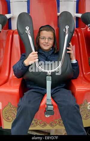 Religious Jewish child on a ride at Luna Park in Coney Island, Brooklyn, New York - Stock Photo