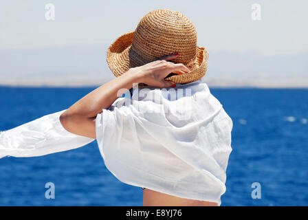 Woman on seaside - Stock Photo