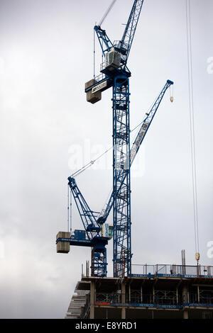 Construction cranes on the skyline at Byron Street, Developments, Liverpool, Merseyside, UK - Stock Photo