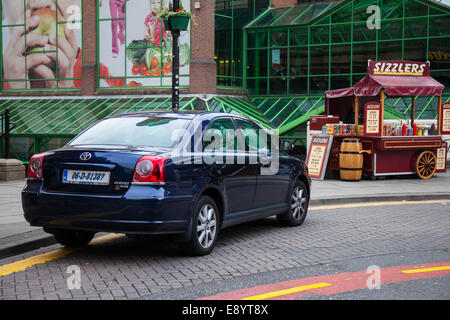 Illegal Parked Foreign Car parked in Liverpool,  Merseyside, UK - Stock Photo