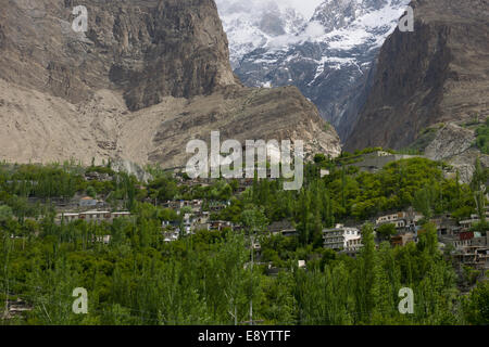 Looking up the valley to Baltit Fort, with snow-capped mountains behind, Karimabad, Hunza Valley, Gilgit-Baltistan, - Stock Photo
