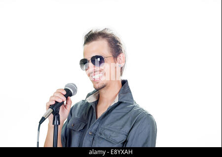 Handsome european singer on the white background - Stock Photo