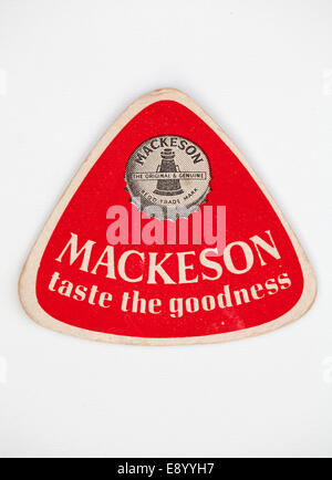 Vintage or Old British Beer mat advertising Mackeson - Stock Photo