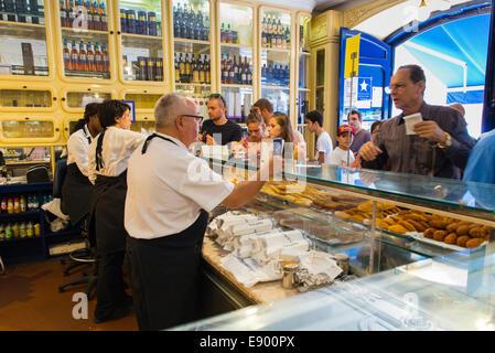 Portugal Lisbon Pasteis de Belem since 1837 pastel de nata custard tart tarts bakery crowd queue counter pastelarias - Stock Photo