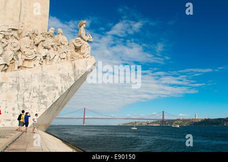 Portugal Lisbon Belem Monument to the Discoveries western face Ponte 25 de Abril River Tagus 1 km suspension bridge - Stock Photo