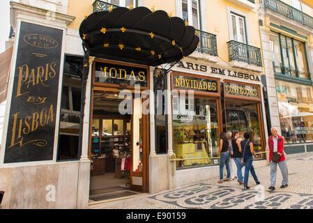 Portugal Lisbon Baixa Chiado Rua Garrett cobbled pedestrian shopping street old fashion clothes art deco store shop - Stock Photo