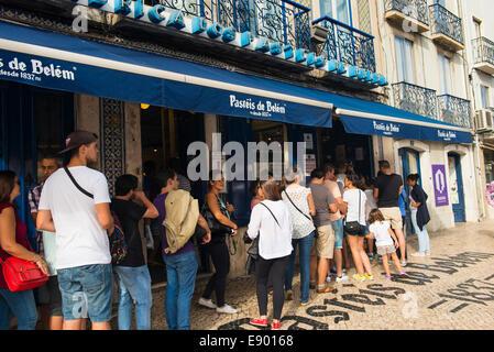 Portugal Lisbon Pasteis de Belem since 1837 pastel de nata custard tart tarts bakery crowd queue pavement sidewalk - Stock Photo