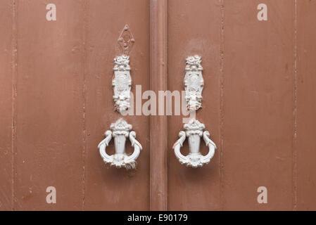 Portugal Algarve Tavira late Bronze Age port rebuilt 18th cent ornamental doors trimmings furniture knockers municipal - Stock Photo