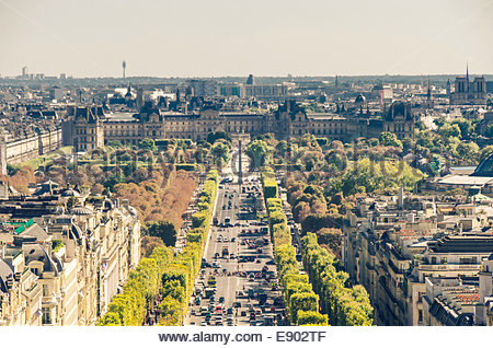 View of champs elysees boulevard, concorde place and Louvre museum as seen from Triumph arch in Paris - Stock Photo