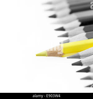 One yellow pencil standing out from others