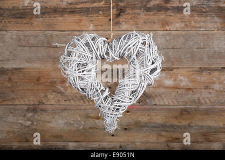 Heart Shape White Christmas Wreath From Natural Painted Twigs On Old Wooden Rustic Background