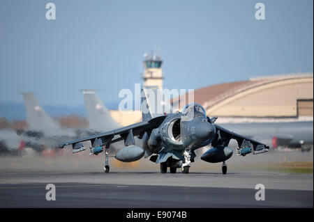 A U.S. Marine Corps AV-8B Harrier II aircraft assigned to Marine Attack Squadron (VMA) 311 taxis on the flight line - Stock Photo
