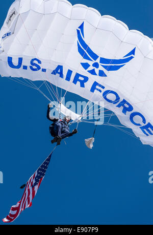 A U.S. Air Force Academy Wings of Blue skydiver flies over Falcon Stadium at the start of the Air Force versus Navy - Stock Photo