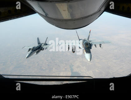 Two U.S. Navy F/A-18E Super Hornet aircraft fly after receiving fuel from an Air Force KC-135 Stratotanker aircraft - Stock Photo