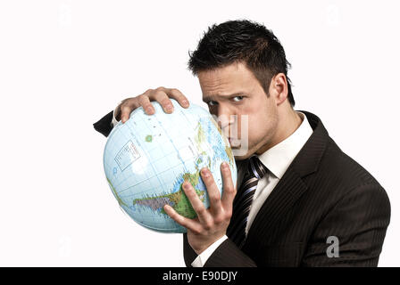Businessman holding a globe in his hand - Stock Photo