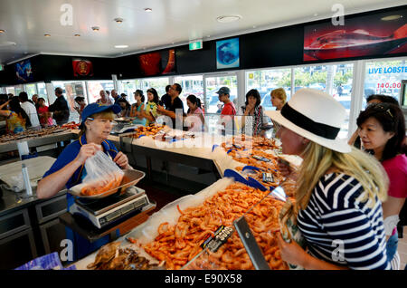 GOLD COAST - OCT 05 2014:Tourist and Australians buys sea food in Charis Seafood. It's one of the most famous and - Stock Photo