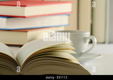 Composition with books and cup of coffee - Stock Photo