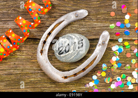 new year 2015 with horseshoe as talisman for good luck - Stock Photo