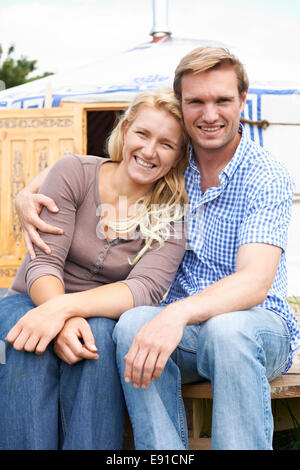 Couple Enjoying Camping Holiday In Traditional Yurt - Stock Photo