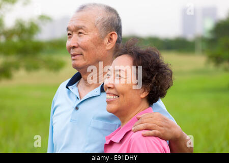 Happy elderly seniors couple in the park. retirement and health concept - Stock Photo