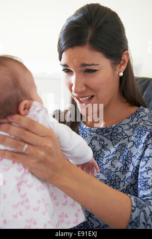 Frustrated Mother Suffering From Post Natal Depression - Stock Photo