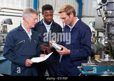Team Of Engineers Having Discussion In Factory - Stock Photo