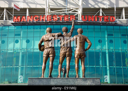 Old Trafford, Manchester, Greater Manchester, England. United Trinity statue outside the Manchester United football - Stock Photo