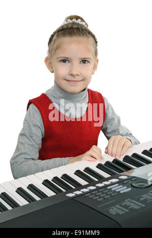 Learning to play on a digital keyboard - Stock Photo