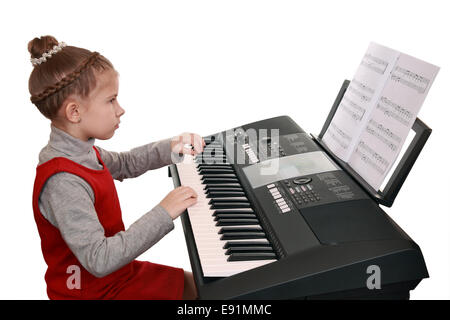 A girl playing on a digital keyboard - Stock Photo