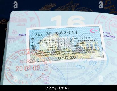 Visa stamps in US passport - Stock Photo