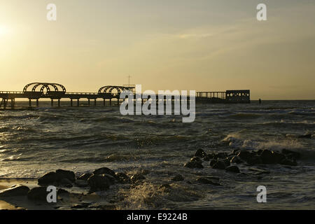 Pier in Kellenhusen, Baltic Sea, at sundown - Stock Photo