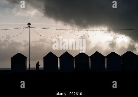 Beach huts on waterfront,storms coming,summer, end, back, school, holidays, beach, concept, blackboard, signboard, - Stock Photo