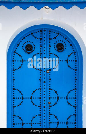 A typical blue, studded wooden door in Sidi Bou Said, Tunisia. - Stock Photo
