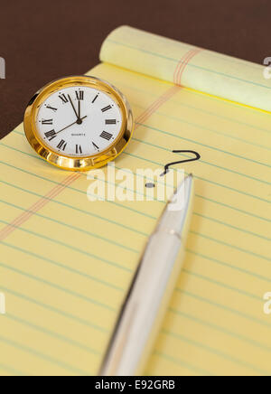 Urgency in making decision with clock - Stock Photo
