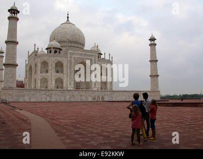 Family waiting for sunrise at the Taj Mahal at Agra - Stock Photo