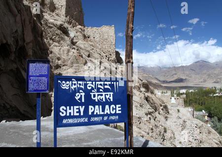 Visitor information sign at historic Shey Palace near Leh in Ladakh - Stock Photo