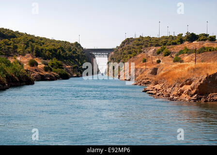 View the Corinth canal and the bridge from the village of Istmia on the Aegean sea in Greece. - Stock Photo