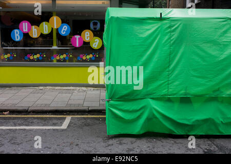 Green tent for street food and circles of Seven Dials tea cafe. - Stock Photo