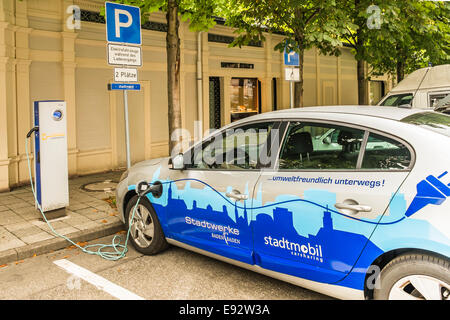 an electric vehicle of the local carsharing enterprise _stadtmobil_ is being charged at a charging station,  baden - Stock Photo